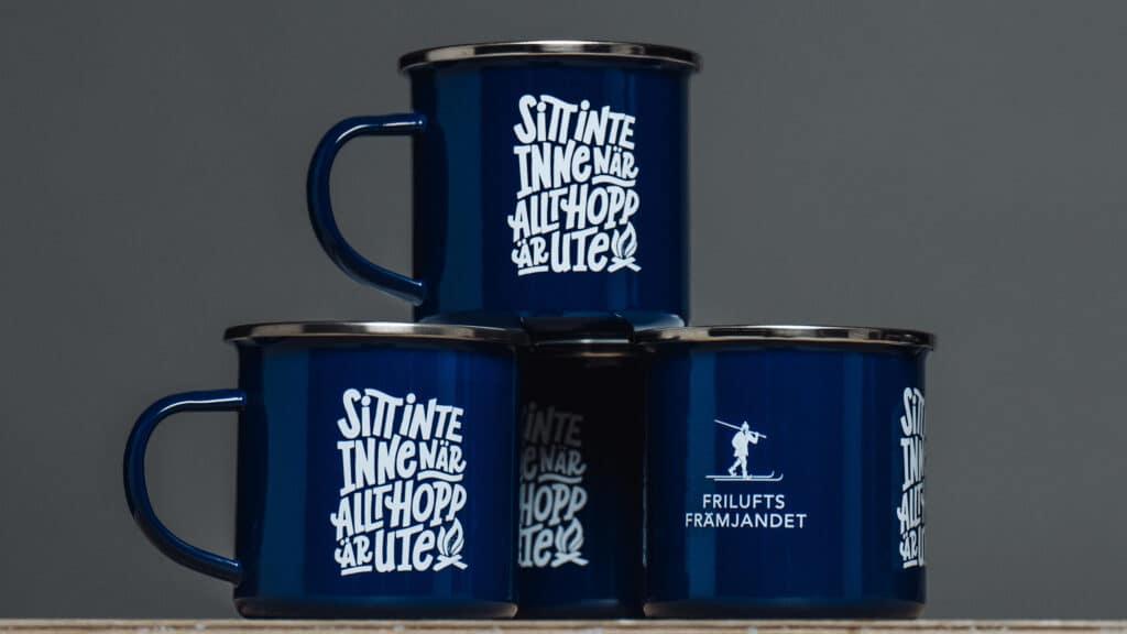 Final lettering on an enamel mug.