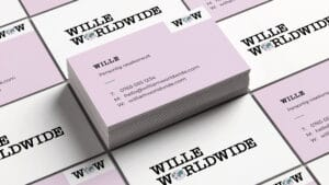 Mockup of business cards with the Wille Worldwide logo.